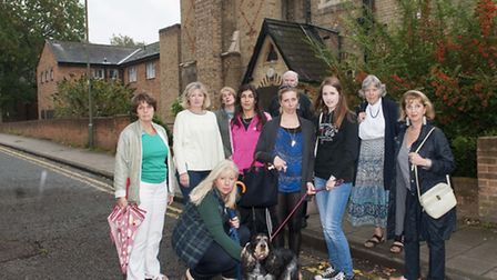Residents opposed to the sale outside Church Walk House. Picture: Nigel Sutton.