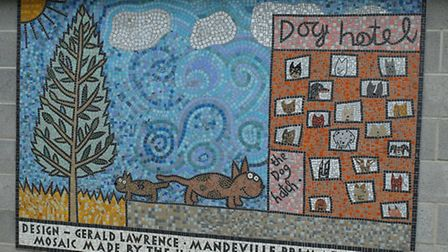 The 'dog hotel' mosaic made by Hackney Mosaic Project
