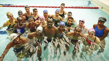 Andy Akinwolere with a group at a Swim Dem Crew training session