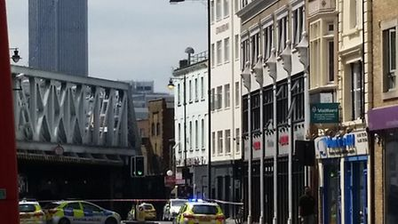 Kingsland Road is blocked as a man threatens to jump off a roof. Photo Hermon Kidane.