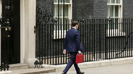 Chancellor of the Exchequer George Osborne leaving Downing Street, London, before heading to the Hou