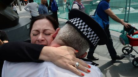 7/7 survivor Gill Hicks hugs Camden PC Andy Maxwell, who came to her aid when she was injured at Kin