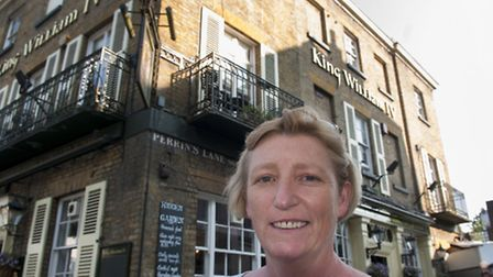 Elaine Loughran outside the King William IV pub in Hampstead. Picture: Nigel Sutton