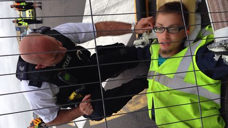 Picture released by Plane Stupid of a police officer talking to one of their activists.