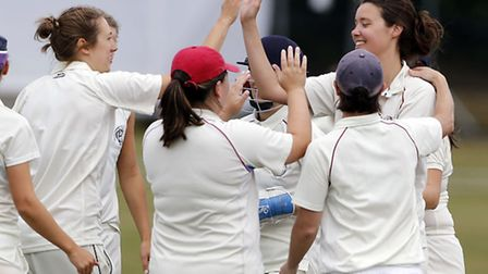Rachael Hewer (right) is congratulated after taking a wicket. Pic: Max Flego