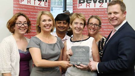 Homerton Hospital's TB team receiving the award, with Jaselle Williams (left) and Jeremy Miles (righ