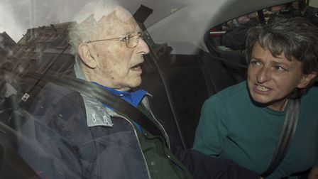 Lord Janner leaves Westminster Magistrates' Court by car with his daughter. Picture: PA/Anthony Devl