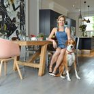 CelinaTeague in the dining/kitchen area with Rifa the dog