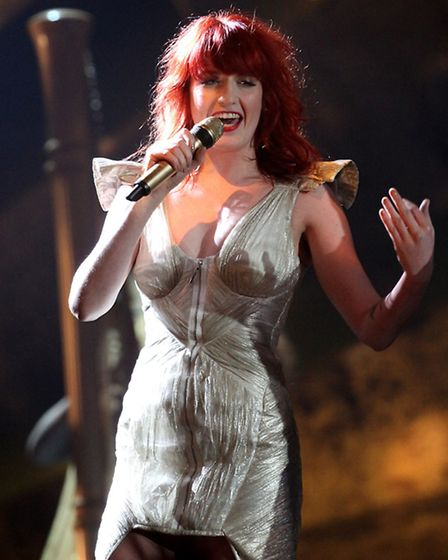 Florence Welch, aka Florence and the Machine, performs on stage during the BRIT Awards 2010, wearing