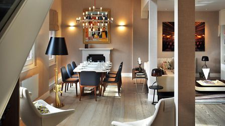 The open-plan contemporary living-dining area with Schotten & Hansen wood flooring