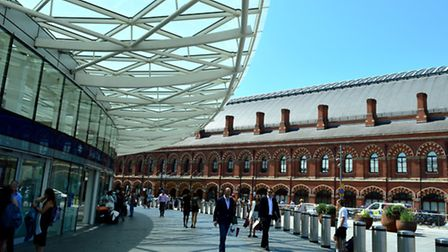 Uber taxi drivers parking outside St Pancras International station are causing traffic problems.