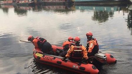 Police and rescue crews try to find the male in the water (Picture: B.W)
