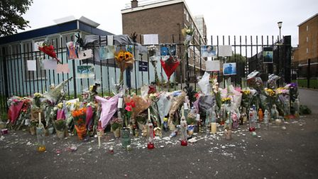 Floral tributes left at St John's Estate in Pitfield Street where Detectives investigating the murde