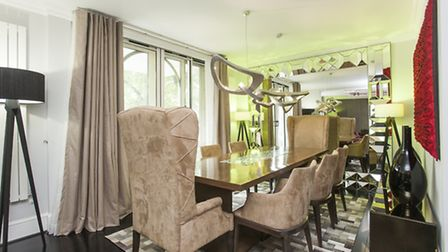 The dining room has space for up to eight guests and leads onto a balcony