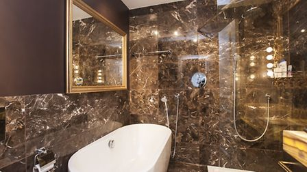The marble covered master bathroom