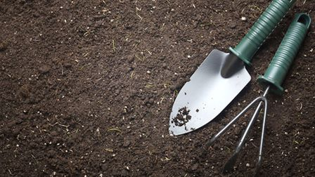 Photo of gardening tools lying in some soil. PA Photo/thinkstockphotos