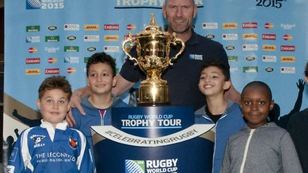 Lawrence Dallaglio pictured alongside the Webb Ellis trophy with children from Hackney RFC
