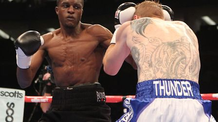 Ohara Davies (left) in action against Andy Harris at the O2 Arena. Pic: Chris Royle/TGSPHOTO