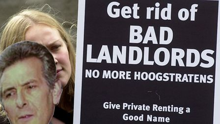 Kathryn Busby, from the charity Shelter, demonstrates against bad landlords outside the Old Bailey i