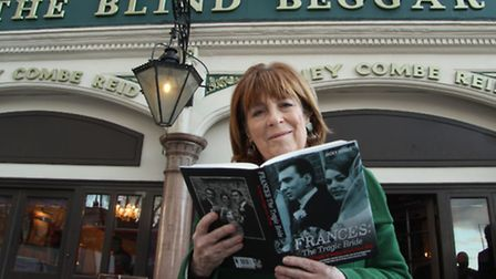 Author Jacky Hyams with her book on tragic Frances Kray... outside Blind Beggar in Whitechapel where