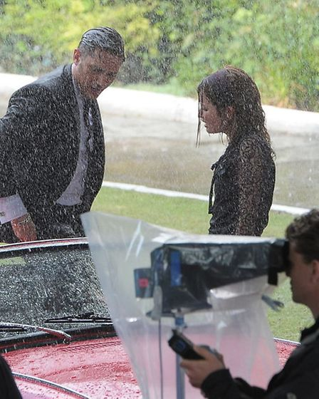 Tom Hardy as Reggie and Emily Browning as Frances... filming last summer outside Cedra Court in Cla