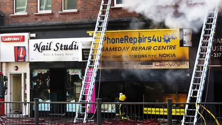 Firefighters continue to tackle the blaze in Finchley Road. Picture: Shademan Irvanipour