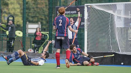 David Cooper (left, on the floor) celebrates his opening goal for Hampstead & Westminster. Pic: Mark