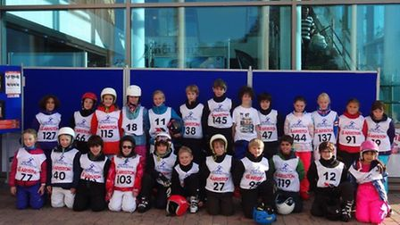 The 24 competitors from The Hall and South Hampstead High School pose together after their success a