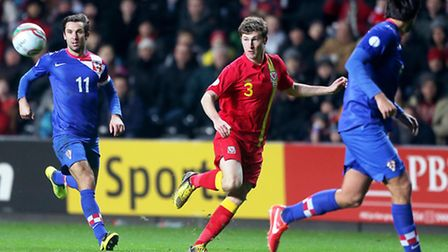 Tottenham left-back Ben Davies (centre) in action for Wales