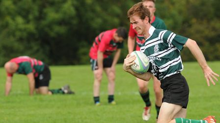 Chess Valley's players look well beaten as Mike Evans-Jones runs in Hendon's 14th and final try. Pic