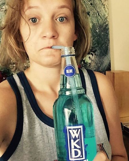 Bella Younger getting her fix of electrolyes with the WKD drink