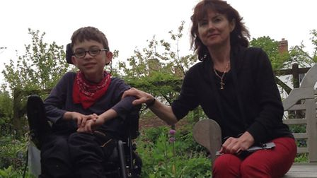 Theo Seddon-Deane, who has cerebral palsy, with mother Catharine Seddon