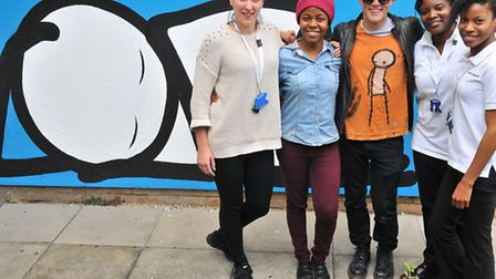 Stik with staff from the Homerton next to his mural there