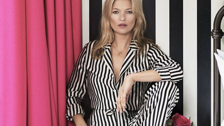 Kate Moss matching her pjs with her wallpaper