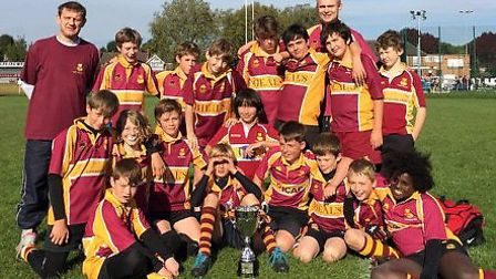 Hampstead's Under-12s show off their trophy after winning the Blackheath Festival tournament