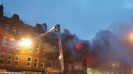 Firefighters tackle the blaze on Monday evening. Picture: @WearywithToil