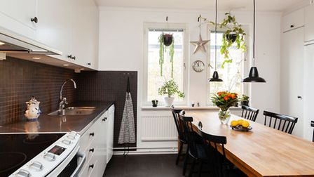 A kitchen with a dining table. PA Photo/thinkstockphotos