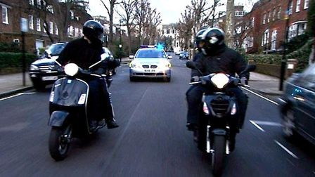 Stock picture of moped-riding robbers. Picture: Met Police/PA Archive