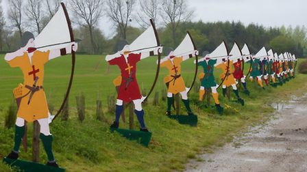 At the village of Azincourt, life-size cartoon-cut-outs of English longbowmen greet visitors