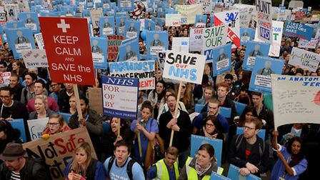 Demonstrators listen to speeches in Waterloo Place during the 'Let's Save the NHS' rally and protest