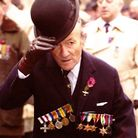John Davis wearing replicas of his and his father's medals at the AJEX parade in 2001