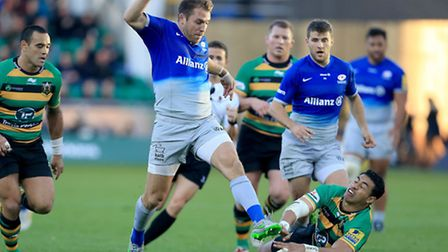Chris Wyles (centre) tries to hack the ball through during Saracens' Premiership victory over Northa