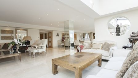 The living areas are finished with cream tiles
