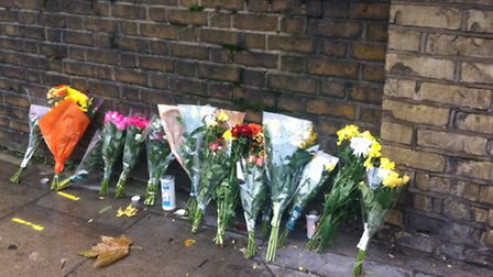 Flowers on West End Lane where Desreen Brooks was killed three years ago