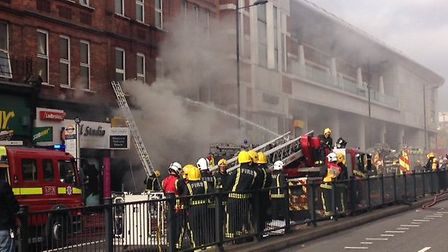 Firefighters tackling the fire in Finchley Road