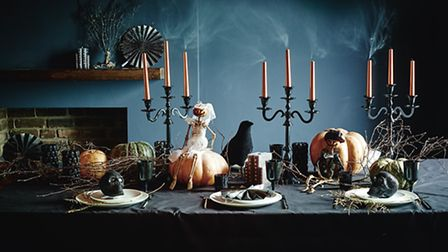For a more grown up affair, set the table with candles, twigs and pumpkins and add this great array