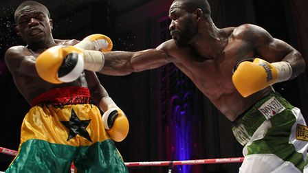 Larry Ekundayo (green/white shorts) defeated Joseph Lamptey to win the African Boxing Union welterwe