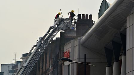 Firefighters tackle the blaze on Tuesday. Picture: Polly Hancock