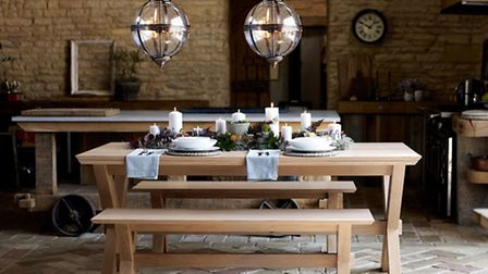 There's a rustic grandeur to a Wilmore Extending Dining Table, �699, and matching Wilmore Bench, �29