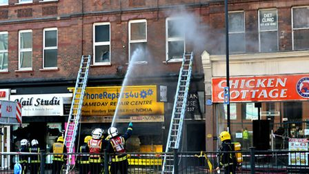 Fire crews tackle the blaze in Finchley Road. Picture: Polly Hancock